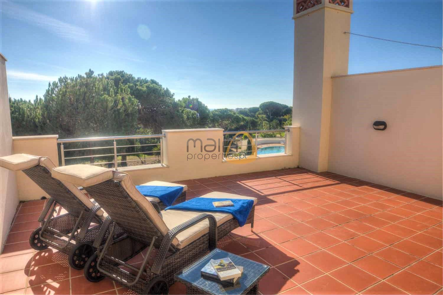 Casa Amelda rooftop terrace with views over golf and pool